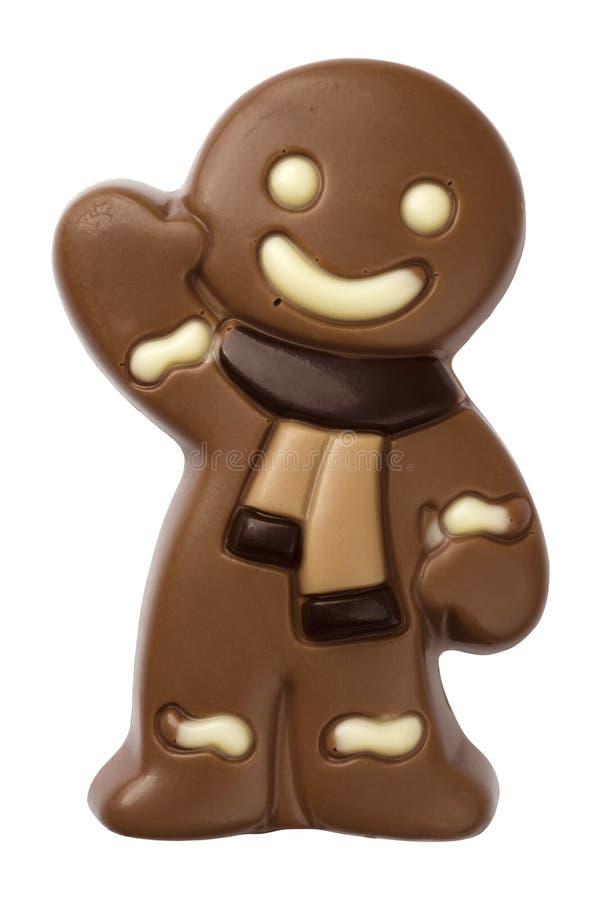 Figura del hombre de pan de jengibre de la Navidad hecha del chocolate aislado en blanco imagen de archivo libre de regalías