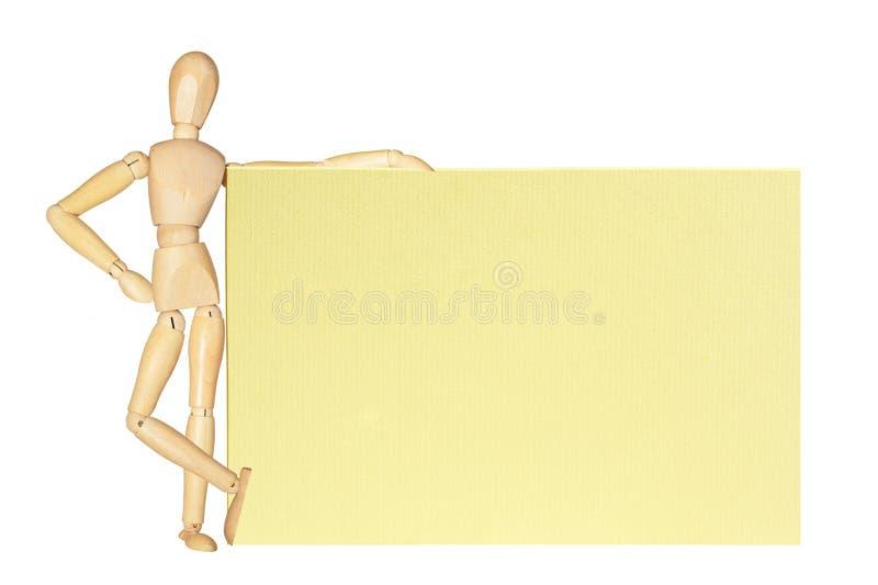Figura di legno con una scheda fotografia stock