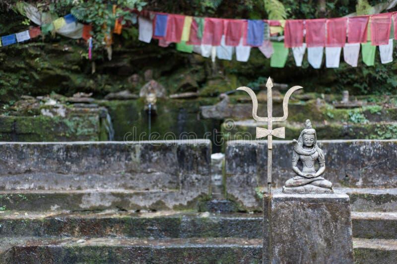 Figura di Shiva ad una molla fotografie stock