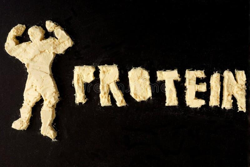 Figura do halterofilista do pó de leite e da proteína da palavra fotografia de stock royalty free