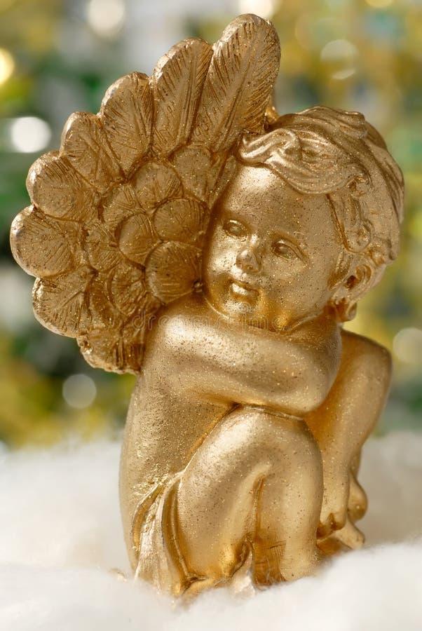 Figura dourada do anjo fotos de stock