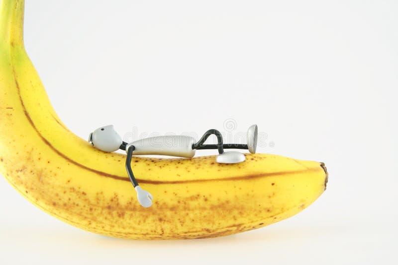 Figura encontra-se na banana fotos de stock royalty free