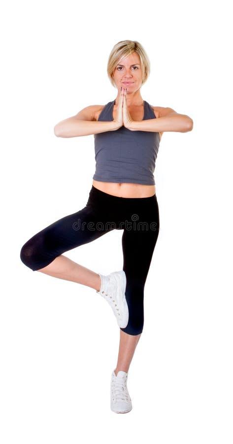 Figura ioga da árvore da mulher foto de stock