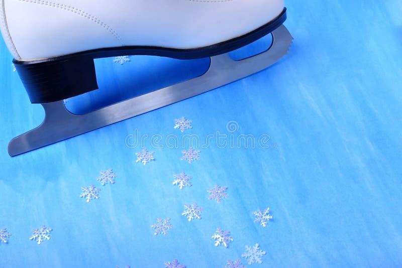 Figura lâmina e flocos de neve do patim foto de stock royalty free
