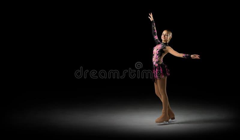 Figura patinador de la chica joven imagen de archivo