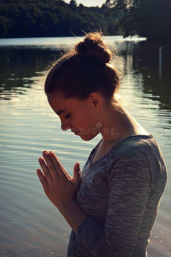 Figura praying da mulher fotografia de stock