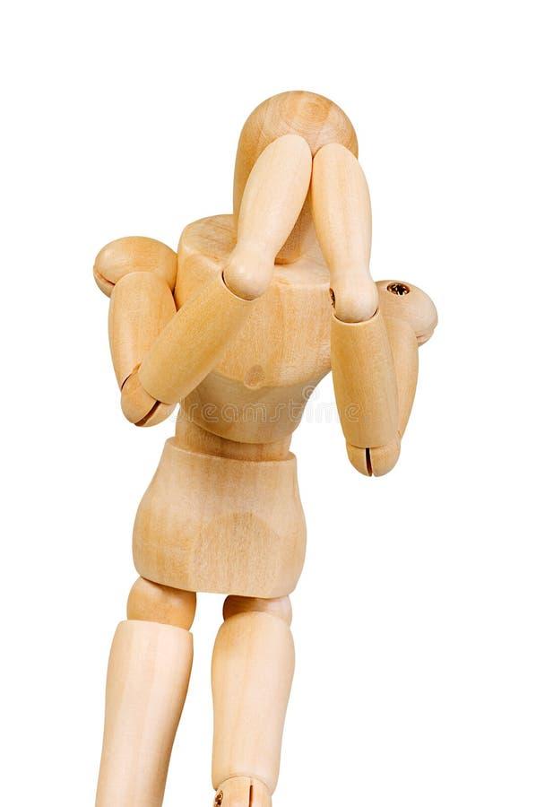 A figura ser humano de madeira da estatueta do homem faz a experiências das mostras a ação emocional em um fundo branco foto de stock royalty free