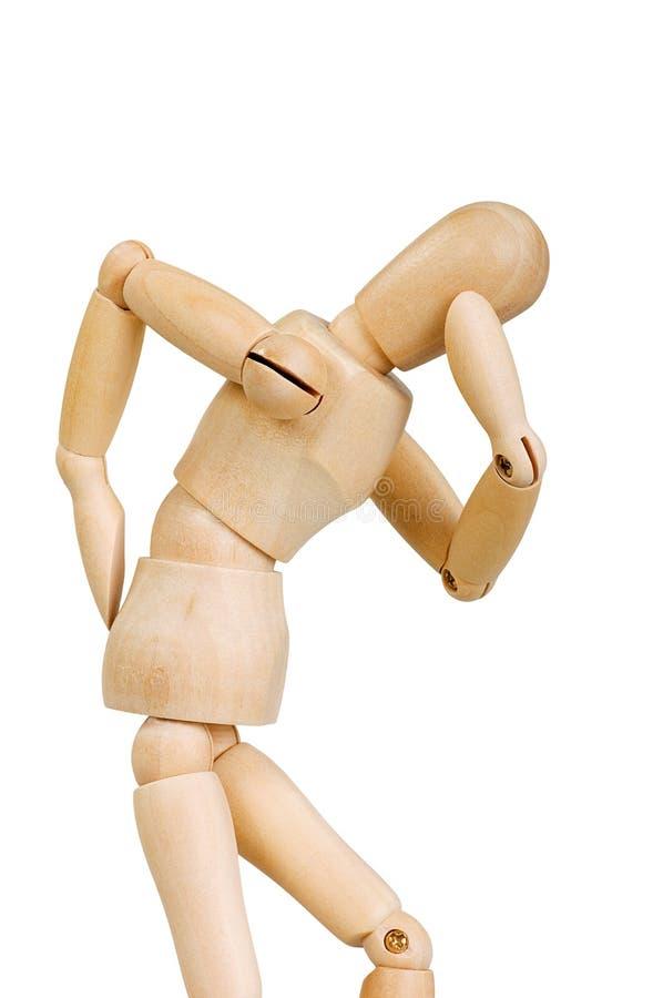 A figura ser humano de madeira da estatueta do homem faz a experiências das mostras a ação emocional em um fundo branco fotos de stock royalty free