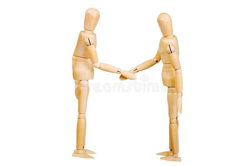 A figura ser humano de madeira da estatueta do homem faz a experiências das mostras a ação emocional em um fundo branco imagens de stock