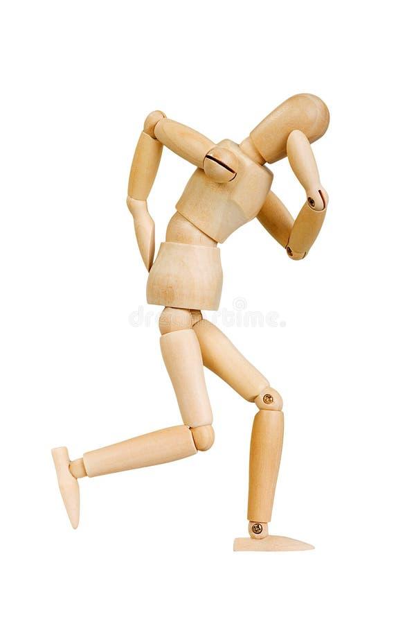 A figura ser humano de madeira da estatueta do homem faz a experiências das mostras a ação emocional em um fundo branco fotos de stock