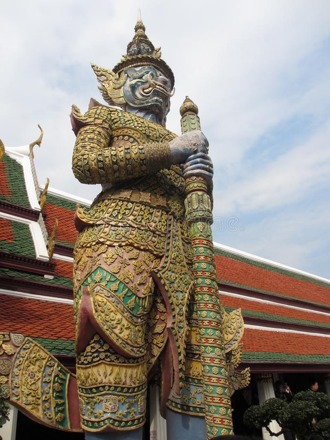 Figura in tempio Wat Phra Kaeo - Emerald Buddha - a Bangkok, Tailandia fotografia stock