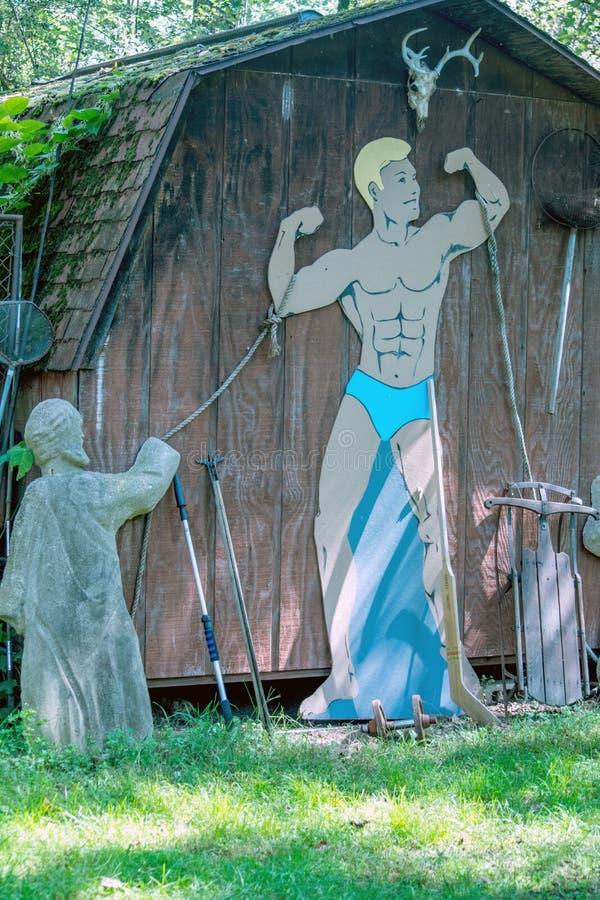 Figura y estatua chistosas del culturista en la dimensión 2, fotos de archivo