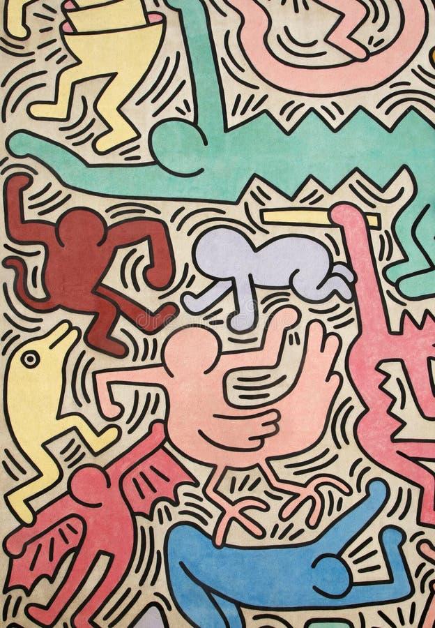 Figuras coloridos pintadas por Keith Haring, vertical imagens de stock royalty free