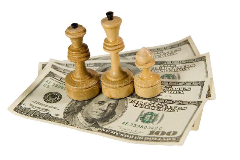 Figuras da xadrez em dólares americanos fotografia de stock royalty free