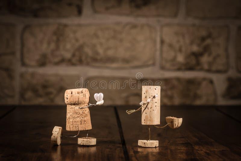 Figuras del corcho del vino, propuesta de matrimonio del concepto fotografía de archivo