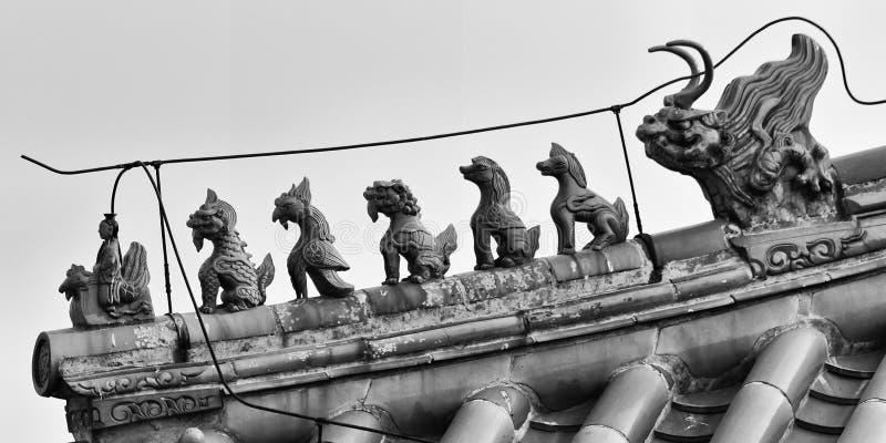 Figuras del tejado de China la ciudad Prohibida imagen de archivo