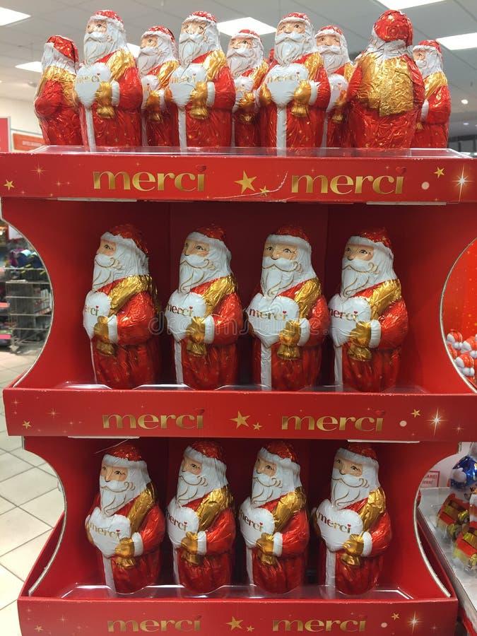 Figuras do Natal do chocolate de Merci fotos de stock