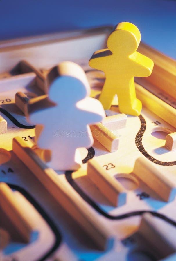 Figuras no labirinto fotografia de stock