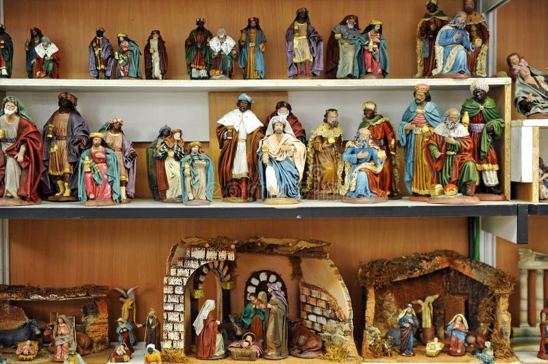 Figuras pequenas de Belen, mercado do Natal fotografia de stock