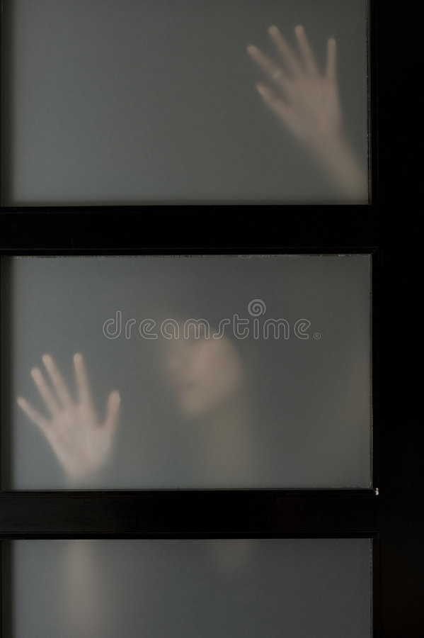 Figure behind screen stock photography