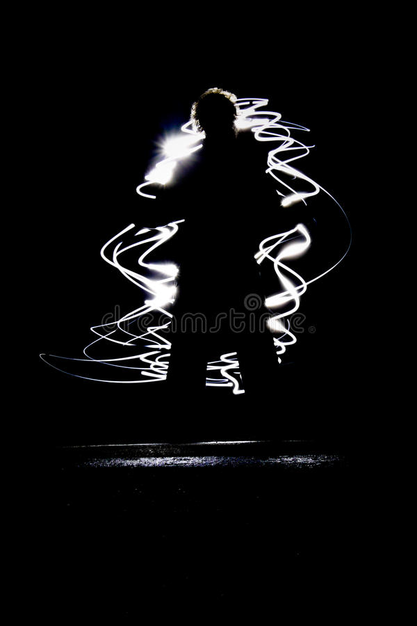 Figure in chaotic lights. Figure of man in chaotic lights with black background royalty free stock image