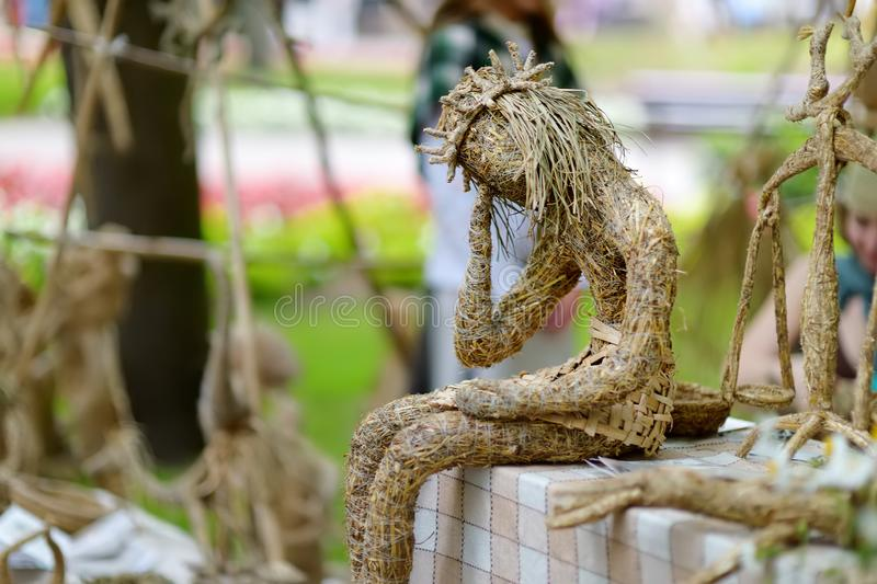 Figure of Christ made of dry grass sold on summer fair in Vilnius stock image