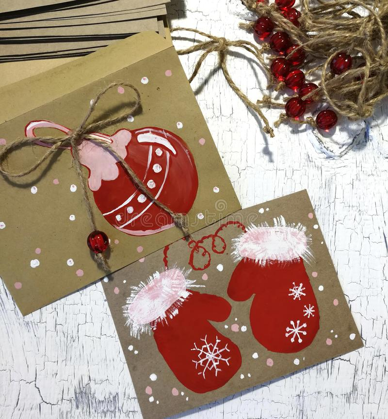 Figure Christmas mitts and a ball in gouache. A close-up photograph depicting a creative art process. A sheet of paper, paints and royalty free stock photography