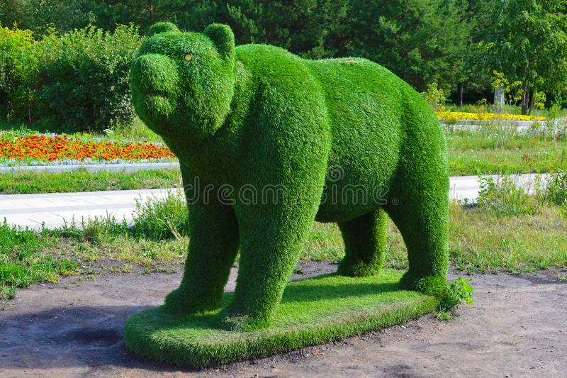 Bear figure of green grass. royalty free stock photography