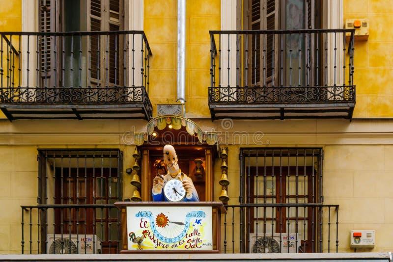 Figure of a clockmaker, in Madrid. MADRID, SPAIN - DECEMBER 31, 2017: Figure of a clockmaker, marking an historical clock shop, in Madrid, Spain stock image