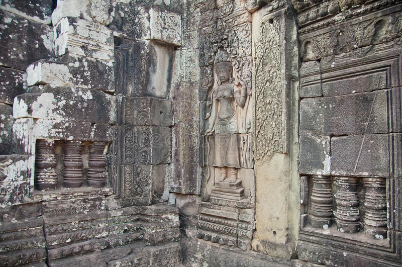 Figure en la pared de una del templo de Angkor imágenes de archivo libres de regalías
