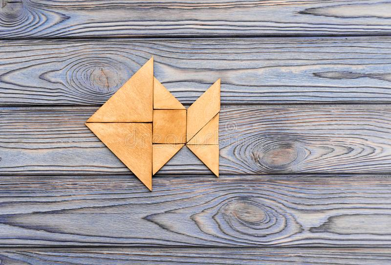 Figure of fish from wooden puzzles royalty free stock images