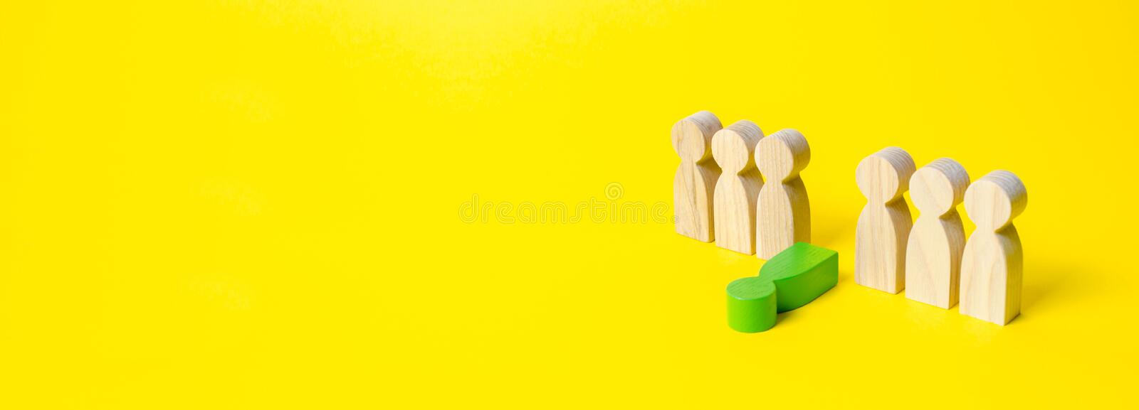 The figure of a green man falls out of a number of people on a yellow background. The concept of a toxic employee in the team. royalty free stock images