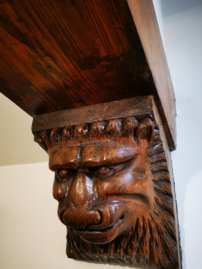 Figure head lion carved in wood in the corner royalty free stock photo