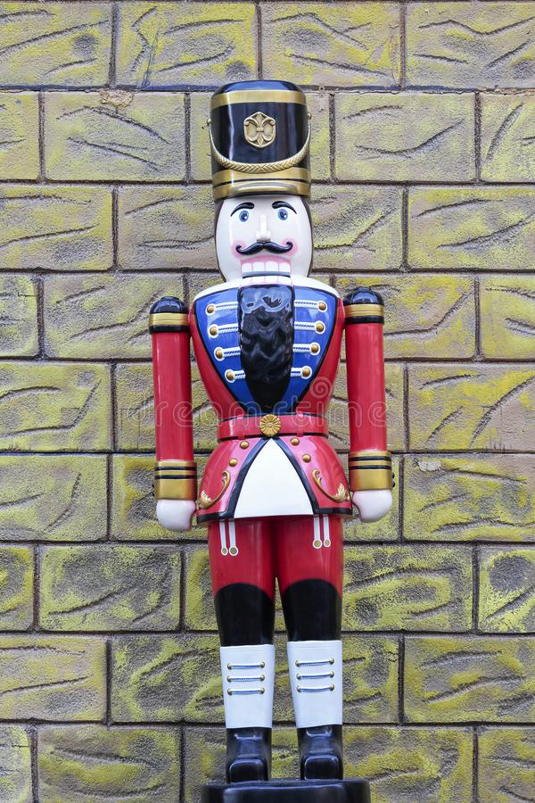 Figure of a lead soldier on a colorful outdoor scenery stock image