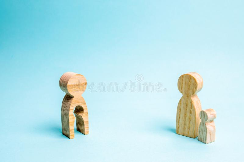 Figure of a man with an empty form in the form of a child and a child. Concept of mother and child, parting. feeling of envy stock photos
