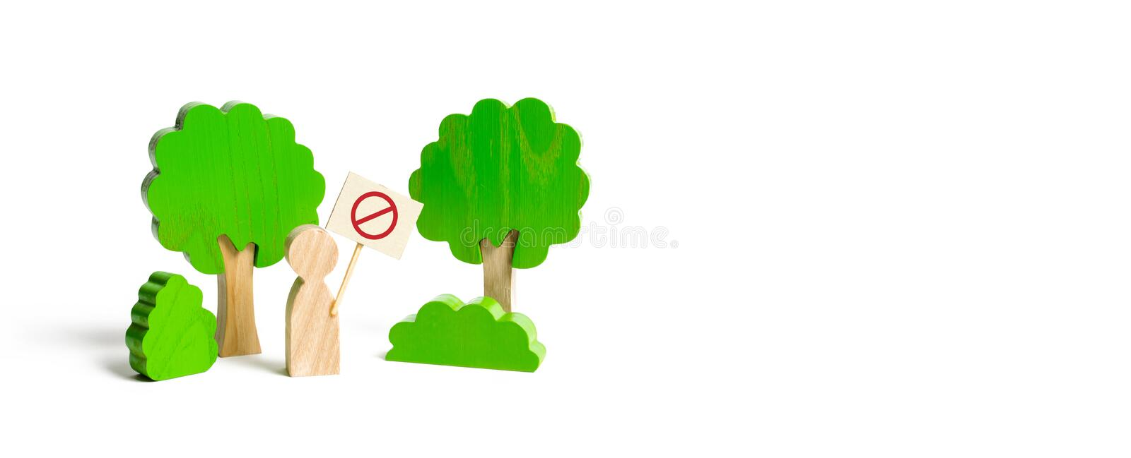 The figure of a man with a poster shows a protest in the forest. Nature reserves, guardian of the environment. Conservation. Of forest from logging and nature royalty free stock image