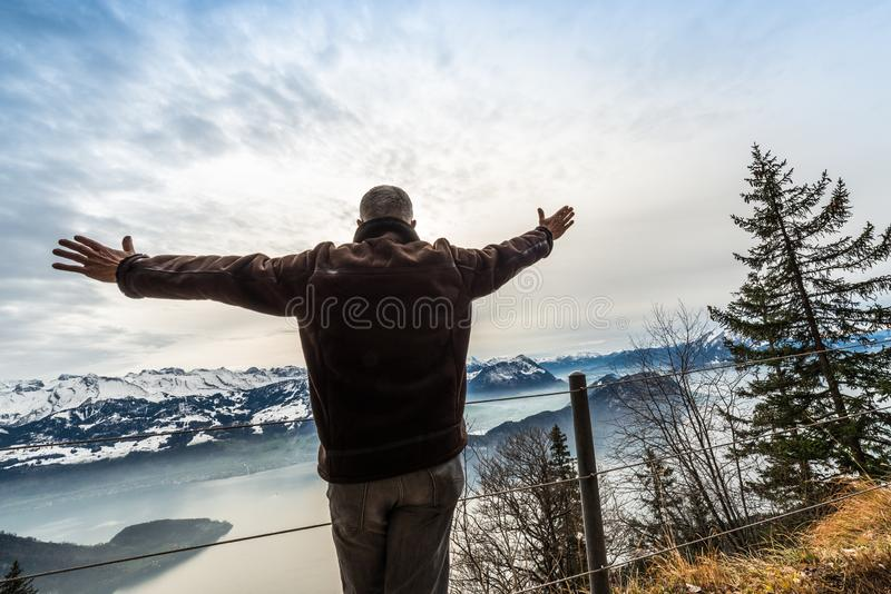 The figure of a man on top of a mountain. The desire to fly away stock images