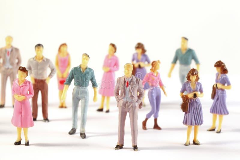 Figure miniatura dell'essere umano immagini stock