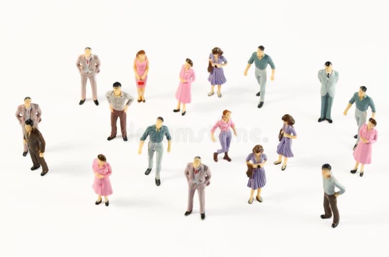 Figure miniatura dell'essere umano in costumi fotografia stock