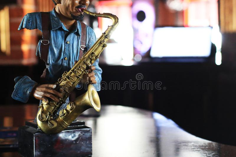 Figure of a musician with a saxophone royalty free stock photography