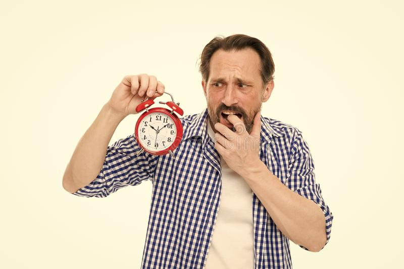 Figure out why you are always late. Man bearded mature guy hold alarm clock. Time management skill. Take control of time stock images