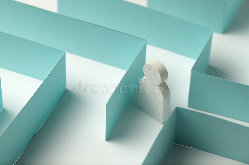 The figure of a person is looking for a way out of the maze, an abstract problem, a challenge royalty free stock photos