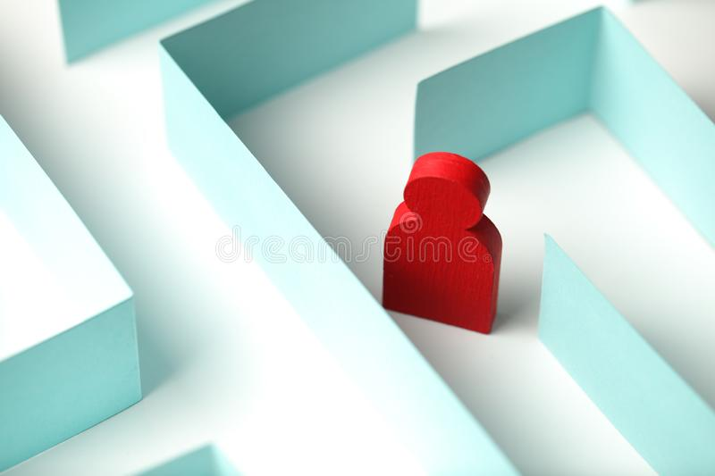 Figure of person is seeking way out of the maze, bureaucratic problems. Personal call stock photo