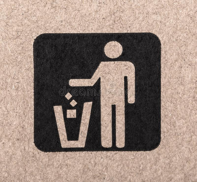 Figure of person throwing garbage into a trash can. royalty free stock image