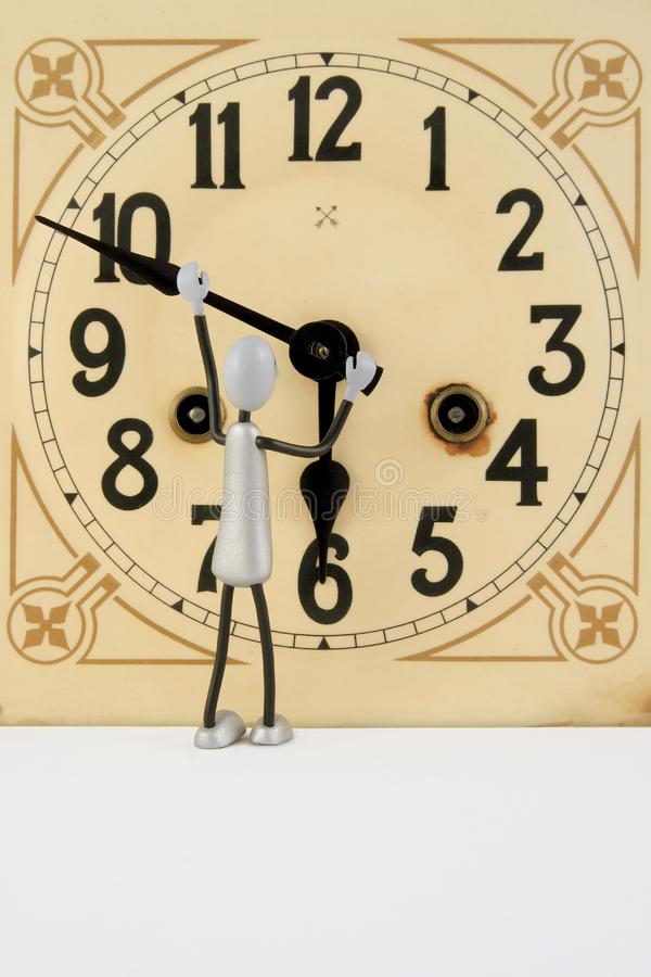 Figure repairs antique clock 1 royalty free stock photography