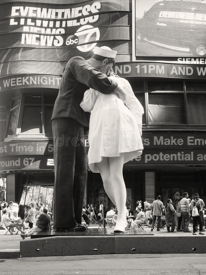 Figure of a sailor kissing a nurse at Times Square in New York. Figure resembling the famous photograph of a sailor kissing a nurse at Times Square in New York royalty free stock photo