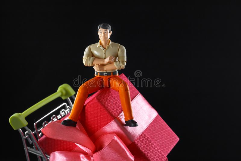 The figure of a satisfied man who bought a great product at a bargain price stock image
