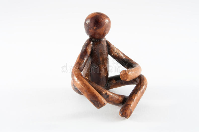 Figure of the sitting person stock photo