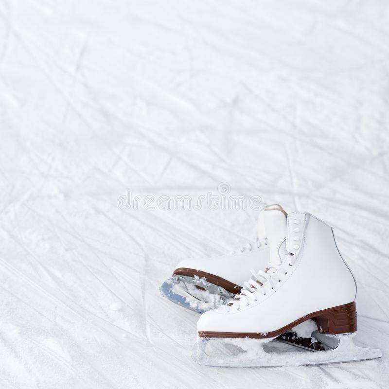 Figure skates and copy space over ice with marks from skating stock image