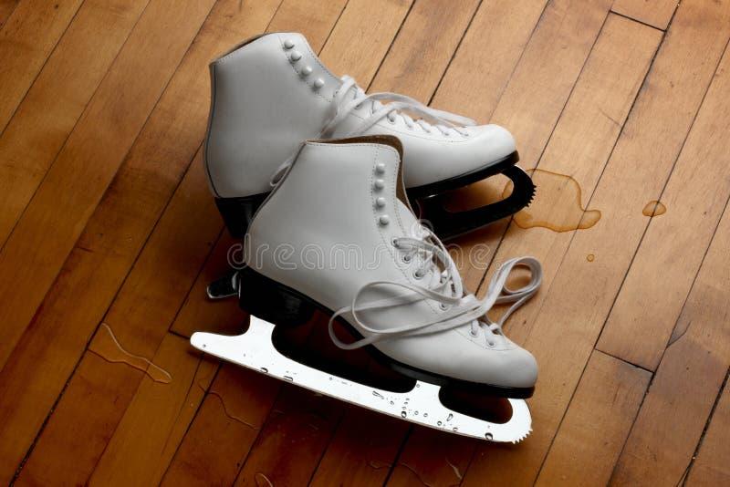 Figure skates on the floor stock photography